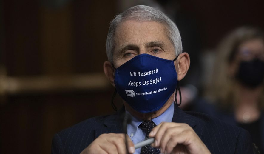Dr. Anthony Fauci, Director of the National Institute of Allergy and Infectious Diseases at the National Institutes of Health, listens during a Senate Senate Health, Education, Labor, and Pensions Committee Hearing on the federal government response to COVID-19 Capitol Hill in Washington, Sept. 23, 2020. Fauci is recommending masks at Thanksgiving gatherings if the coronavirus status of people is unknown.  (Graeme Jennings/Pool via AP)