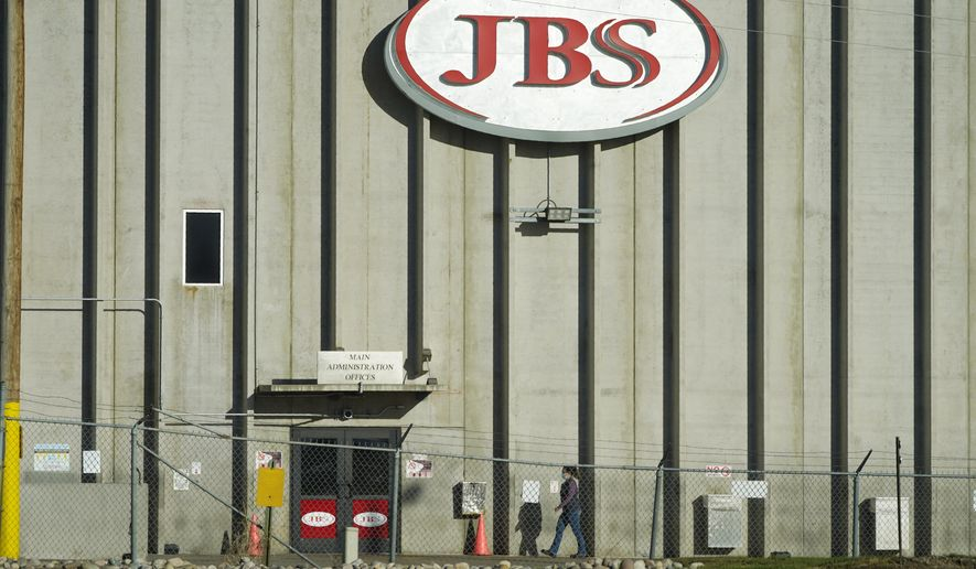 A worker heads into the JBS meatpacking plant Monday, Oct. 12, 2020, in Greeley, Colo. (AP Photo/David Zalubowski)