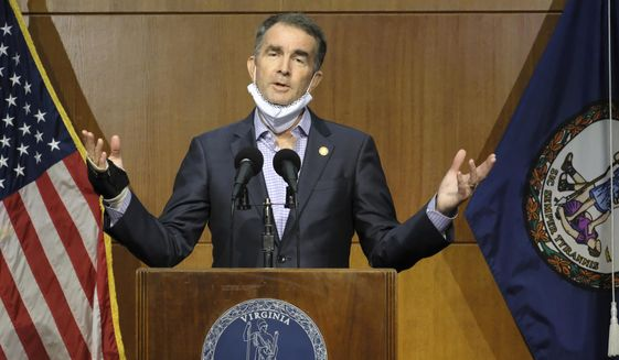 Virginia Gov. Ralph Northam answers a reporter's question dealing with the state's COVID-19 updates during a press conference at the Patrick Henry Building in Richmond, Va., Tuesday, Nov. 10, 2020. (Bob Brown/Richmond Times-Dispatch via AP)