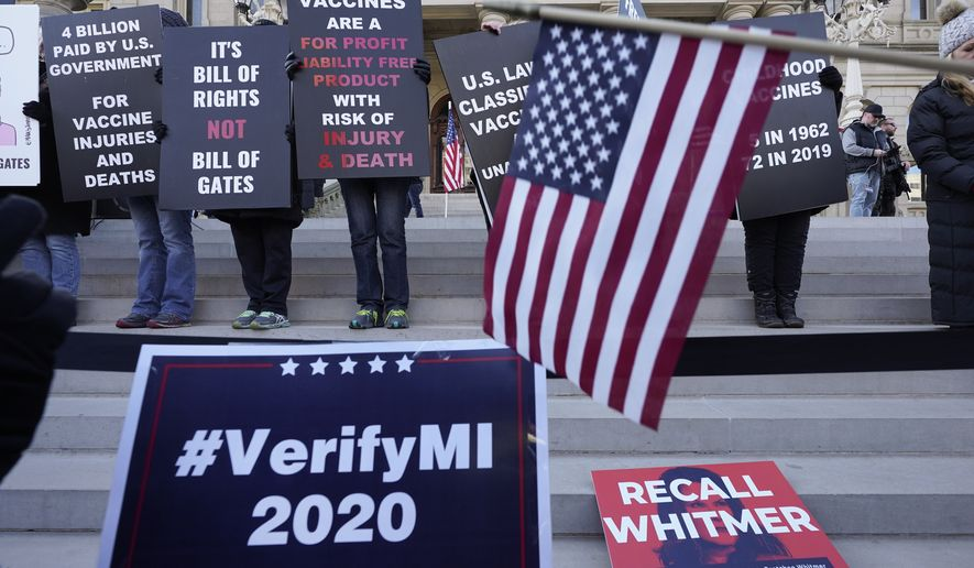 President Trump supporters rally at the Capitol building in Lansing, Mich., Saturday, Nov. 14, 2020. (AP Photo/Paul Sancya)