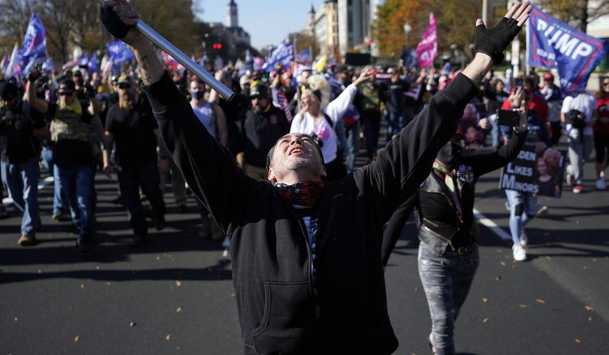 Supporters of President Donald Trump attend a pro-Trump march Saturday, Nov. 14, 2020, in Washington. (AP Photo/Julio Cortez)