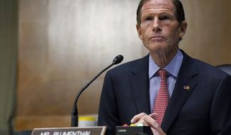FILE- In this Nov. 10, 2020 file photo, Sen. Richard Blumenthal, D-Conn., speaks during a Senate Judiciary Committee hearing on Capitol Hill in Washington. Blumenthal and Connecticut Sen. Chris Murphy will be self-isolating after a member of Connecticut Gov. Ned Lamont's staff tested positive for COVID-19. Both tweeted on Saturday, Nov. 14, 2020, that they had not had close contact with the staffer but were taking the step out of an abundance of caution. (AP Photo/Susan Walsh, Pool, File)