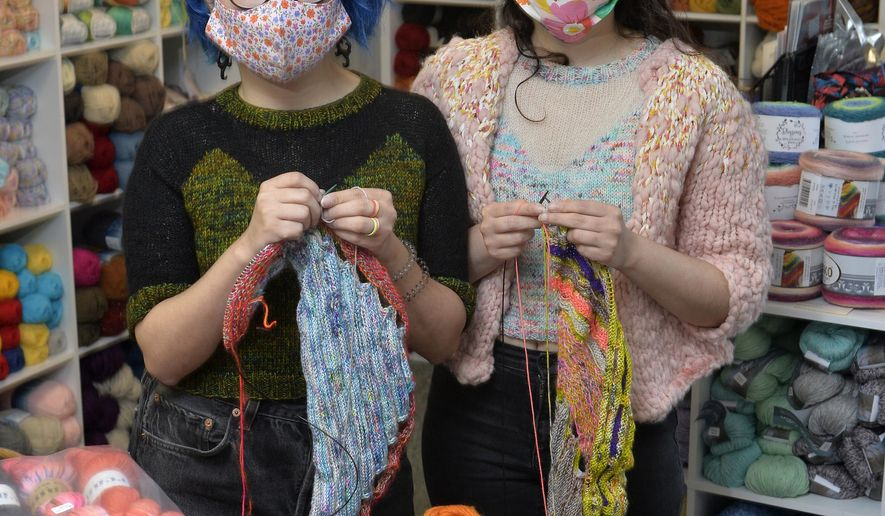 Twins Jes Velez, left, and Erica Velez, both 30, visit Habetrot's Wheel, the knitting-supply shop they frequent, on Saturday, Oct. 24, 2020, in Harborcreek Township, Pa.. The women enjoy knitting a variety of items including the sweaters they both wear. (Greg Wohlford/Erie Times-News via AP)
