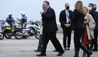 U.S. Secretary of State Mike Pompeo, left, walks to a motorcade vehicle after stepping off a plane at Paris Le Bourget Airport, Saturday, Nov. 14, 2020, in Le Bourget, France. Pompeo is beginning a 10-day trip to Europe and the Middle East. (AP Photo/Patrick Semansky, Pool)