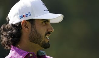 Abraham Ancer, of Mexico, watches his tee shot on the sixth hole during the third round of the Masters golf tournament Saturday, Nov. 14, 2020, in Augusta, Ga. (AP Photo/Charlie Riedel)