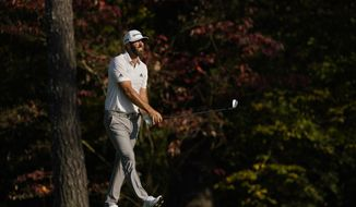 Dustin Johnson watches his second shot on the 11th hole during the third round of the Masters golf tournament Saturday, Nov. 14, 2020, in Augusta, Ga. (AP Photo/David J. Phillip)