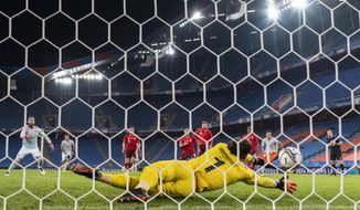 Switzerland's goalkeeper Yann Sommer, front, blocks a penalty shot by Spain's Sergio Ramos, left, during the UEFA Nations League soccer match between Switzerland and Spain at the St. Jakob-Park stadium in Basel, Switzerland, Saturday Nov. 14, 2020. (Alessandro della Valle/Keystone via AP)