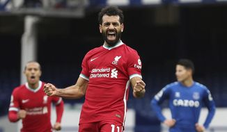 FILE - In this Oct. 17, 2020 file photo Liverpool's Mohamed Salah celebrates scoring his side's second goal during the English Premier League soccer match between Everton and Liverpool at Goodison Park stadium, in Liverpool, England. Salah has tested positive for the coronavirus. The announcement was made by the Egyptian soccer association on Twitter, Friday, Nov. 13, ahead of Saturday's game against Togo. (Cath Ivill/Pool via AP, File)