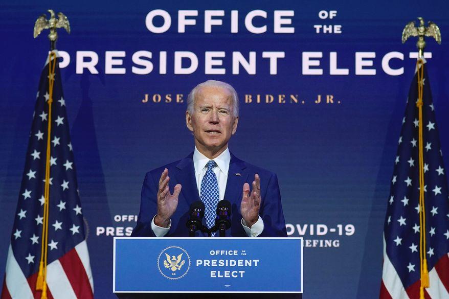 "Already billed as ""President-elect Joe Biden,"" Joseph R. Biden speaks at The Queen theater on Nov. 9 in Wilmington, Delaware. (Associated Press)"