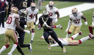 New Orleans Saints running back Alvin Kamara (41) carries on a 34 yard pass play in the first half of an NFL football game against the San Francisco 49ers in New Orleans, Sunday, Nov. 15, 2020. (AP Photo/Butch Dill)