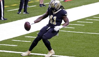 New Orleans Saints running back Alvin Kamara (41) crosses the goal line untouched for his second touchdown in the first half of an NFL football game against the San Francisco 49ers in New Orleans, Sunday, Nov. 15, 2020. (AP Photo/Butch Dill)