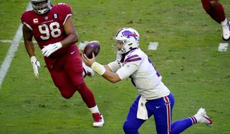 Buffalo Bills quarterback Josh Allen (17) pulls in a touchdown catch from wide receiver Isaiah McKenzie as Arizona Cardinals defensive tackle Corey Peters (98) pursues during the first half of an NFL football game, Sunday, Nov. 15, 2020, in Glendale, Ariz. (AP Photo/Ross D. Franklin)