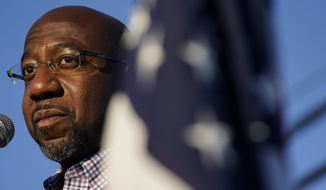 Raphael Warnock, a Democratic candidate for the U.S. Senate speaks during a campaign rally on Sunday, Nov. 15, 2020, in Marietta, Ga. Warnock and U.S. Senate Sen. Kelly Loeffler are in a runoff election for the Senate seat. (AP Photo/Brynn Anderson)