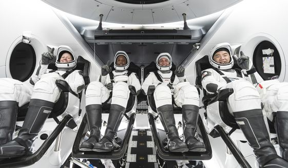 This undated photo made available by SpaceX in September 2020 shows, from left, NASA astronauts Shannon Walker, Victor Glover, commander Mike Hopkins and Japan Aerospace Exploration Agency astronaut Soichi Noguchi inside SpaceX's Crew Dragon spacecraft. The four are scheduled to be SpaceXs second crew launch in mid-November 2020. (SpaceX via AP)