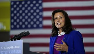File-This Oct. 16, 2020, file photo shows Michigan Gov. Gretchen Whitmer speaking during an event with Democratic presidential candidate former Vice President Joe Biden at Beech Woods Recreation Center, in Southfield, Mich. Whitmer's administration on Sunday, Nov. 15, 2020, ordered high schools and colleges to stop in-person classes, closed restaurants to indoor dining and suspended organized sports  including the football playoffs  in a bid to curb the state's spiking coronavirus cases. The restrictions will begin Wednesday and last three weeks. (AP Photo/Carolyn Kaster, File)