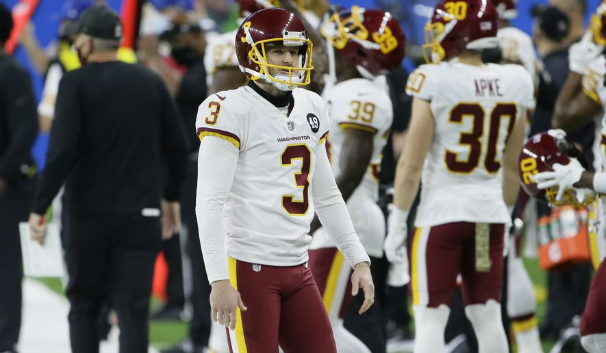 Washington Football Team kicker Dustin Hopkins (3) watches against the Detroit Lions during the first half of an NFL football game, Sunday, Nov. 15, 2020, in Detroit. (AP Photo/Duane Burleson)