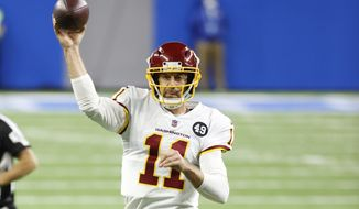 Washington Football Team quarterback Alex Smith (11) passes against the Detroit Lions in the second half during an NFL football game, Sunday, Nov. 15, 2020, in Detroit. (AP Photo/Rick Osentoski)