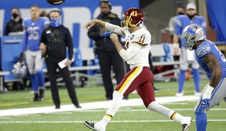 Washington Football Team quarterback Alex Smith (11) passes against the Detroit Lions during an NFL football game, Sunday, Nov. 15, 2020, in Detroit. (AP Photo/Rick Osentoski)