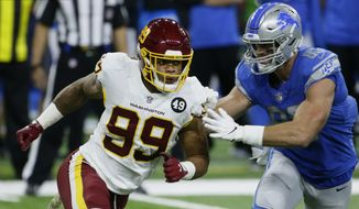 Washington Football Team defensive end Chase Young (99) rushes against Detroit Lions tight end Jesse James (83) during the first half of an NFL football game, Sunday, Nov. 15, 2020, in Detroit. (AP Photo/Duane Burleson)