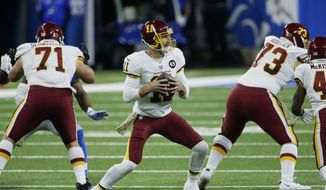 Washington Football Team quarterback Alex Smith (11) plays against the Detroit Lions during the first half of an NFL football game, Sunday, Nov. 15, 2020, in Detroit. (AP Photo/Duane Burleson)