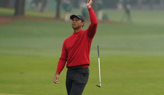 Tiger Woods reacts after a near chip in on the second hole during the final round of the Masters golf tournament Sunday, Nov. 15, 2020, in Augusta, Ga. (AP Photo/Chris Carlson)