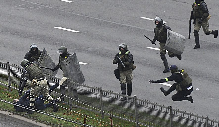 Belarusian riot police detain a demonstrator during an opposition rally to protest the official presidential election results in Minsk, Belarus, Sunday, Nov. 15, 2020. A Belarusian human rights group says more than 500 people have been arrested in protests around the country calling for authoritarian President Alexander Lukashenko to step down. The Sunday demonstrations continued to wave of near-daily protests that have gripped Belarus since early August. (AP Photo)