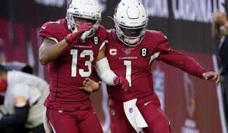 Arizona Cardinals quarterback Kyler Murray (1) celebrates his touchdown run with wide receiver Christian Kirk (13) during the second half of an NFL football game against the Buffalo Bills, Sunday, Nov. 15, 2020, in Glendale, Ariz. (AP Photo/Ross D. Franklin)