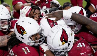 The Arizona Cardinals celebrate after their game winning touchdown against the Buffalo Bills during the second half of an NFL football game, Sunday, Nov. 15, 2020, in Glendale, Ariz. The Cardinals won 32-20. (AP Photo/Ross D. Franklin)