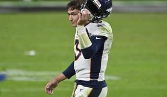 Denver Broncos quarterback Drew Lock (3) takes off his helmet after a play against the Las Vegas Raiders during the second half of an NFL football game, Sunday, Nov. 15, 2020, in Las Vegas. (AP Photo/David Becker)