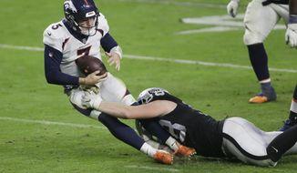 Las Vegas Raiders defensive end Maxx Crosby (98) sacks Denver Broncos quarterback Drew Lock (3) during the second half of an NFL football game, Sunday, Nov. 15, 2020, in Las Vegas. (AP Photo/Isaac Brekken)