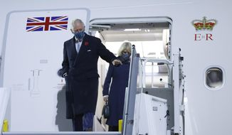 Britain's Prince Charles, and his wife Camilla, Duchess of Cornwall exit their plane as they arrive at Berlin Brandenburg Airport, Germany, Saturday Nov. 14, 2020. (Odd Andersen/Pool via AP)