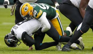 Jacksonville Jaguars' Jake Luton is sacked by Green Bay Packers' Rashan Gary during the second half of an NFL football game Sunday, Nov. 15, 2020, in Green Bay, Wis. The Packers won 24-20. (AP Photo/Matt Ludtke)