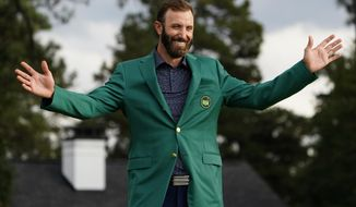 Masters golf champion Dustin Johnson shows off his green jacket after his victory Sunday, Nov. 15, 2020, in Augusta, Ga. (AP Photo/Matt Slocum)