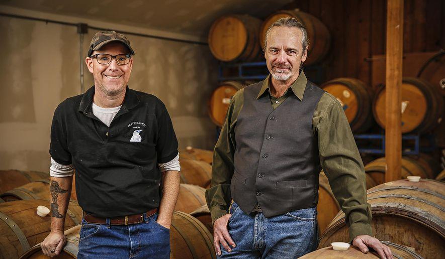 Will Neiman and Dan Murphy of White Raven Winery pose in Columbia Falls, Montana on Nov. 4, 2020. Neiman and Murphy are using Montana-grown grapes to make wines. (Hunter D'Antuono /Flathead Beacon via AP)