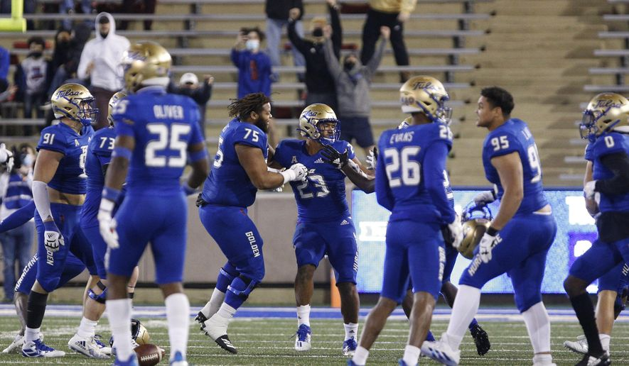 Tulsa celebrates after linebacker Zaven Collins (23) made a winning interception against SMU during the second half of an NCAA college football game in Tulsa, Okla., Saturday, Nov. 14, 2020. (AP Photo/Joey Johnson)  **FILE**