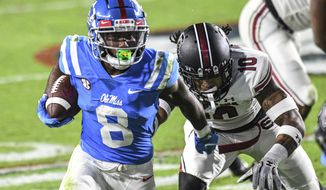 Mississippi wide receiver Elijah Moore (8) is chased by South Carolina defensive back R.J. Roderick (10) during the first half of an NCAA college football game in Oxford, Miss., Saturday, Nov. 14, 2020. (AP Photo/Bruce Newman)
