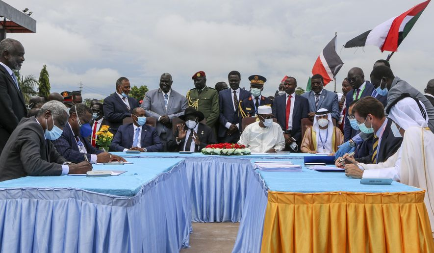 The head of Sudan's sovereign council, Gen. Abdel-Fattah Burhan, seated center-left, President of South Sudan Salva Kiir, seated center, and President of Chad Idriss Deby, seated center-right, attend a ceremony to sign a peace deal between Sudan's transitional authorities and a rebel alliance, in Juba, South Sudan, Saturday, Oct. 3, 2020. Sudan's transitional authorities and a rebel alliance on Saturday signed the peace deal initialed in August that aims to put an end to the country's decades-long civil wars, in a televised ceremony in Juba, South Sudan marking the agreement. (AP Photo/Maura Ajak)