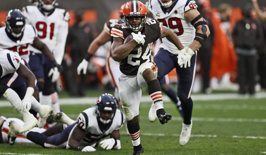 Cleveland Browns running back Nick Chubb (24) rushes for a 9-yard touchdown during the second half of an NFL football game against the Houston Texans, Sunday, Nov. 15, 2020, in Cleveland. (AP Photo/Ron Schwane)