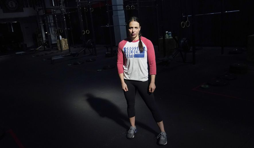 CrossFit Golden Gate owner Danielle Rabkin poses for photos at her gym in San Francisco, Thursday, Nov. 12, 2020. State and local health officials are blaming private gatherings for a surge in California coronavirus cases to levels unseen in months. That has business owners and some health experts scratching their heads over why the state's response has instead been to impose more restrictions on businesses like restaurants and gymnasiums in areas that have been backsliding. (AP Photo/Jeff Chiu)
