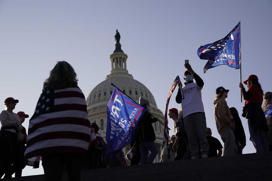 With the U.S. Capitol building in the background, supporters of President Donald Trump attend a pro-Trump march Saturday Nov. 14, 2020, in Washington, in this file photo. (AP Photo/Jacquelyn Martin)  **FILE**