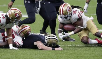 New Orleans Saints quarterback Taysom Hill fumbles as San Francisco 49ers safety Marcell Harris (36) recovers the ball in the second half of an NFL football game in New Orleans, Sunday, Nov. 15, 2020. (AP Photo/Butch Dill)