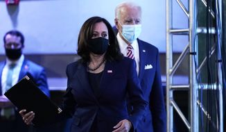 President-elect Joe Biden, accompanied by Vice President-elect Kamala Harris, arrives to speak about economic recovery at The Queen theater, Monday, Nov. 16, 2020, in Wilmington, Del. (AP Photo/Andrew Harnik)