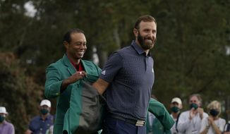 Tiger Woods, left and Dustin Johnson during the final round of the Masters golf tournament Monday, Nov. 16, 2020, in Augusta, Ga. (AP Photo/Charlie Riedel)  **FILE**
