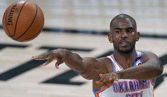 FILE - Oklahoma City Thunder's Chris Paul (3) makes a pass during the first half of an NBA first-round playoff basketball game against the Houston Rockets in Lake Buena Vista, Fla., in this Wednesday, Sept. 2, 2020, file photo. A person with knowledge of the situation says All-Star guard Chris Paul is being traded from the Oklahoma City Thunder to the Phoenix Suns, where he'll play alongside one of the league's most dynamic young scorers in fellow All-Star Devin Booker. The Thunder are acquiring Ricky Rubio, Kelly Oubre, Jalen Lecque, Ty Jerome and a first-round pick that will be conveyed sometime between 2022 and 2025, said the person who spoke to The Associated Press on condition of anonymity because the trade had not been finalized by the league. (AP Photo/Mark J. Terrill, File)