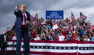 FILE - In this Sept. 8, 2020, file photo, President Donald Trump arrives to speak at a campaign rally at Smith Reynolds Airport in Winston-Salem, N.C. (AP Photo/Evan Vucci, File)