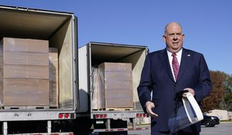 Maryland Gov. Larry Hogan holds a face shield as he speaks during a news conference in Annapolis, Md., Monday, Nov. 16, 2020, in front of several truckloads of face shields. Hardwire LLC donated 200,000 face shields to provide protection for Maryland teachers and students during the coronavirus pandemic. (AP Photo/Susan Walsh) **FILE**