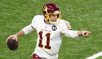 Washington Football Team quarterback Alex Smith scrambles during the second half of an NFL football game against the Detroit Lions, Sunday, Nov. 15, 2020, in Detroit. (AP Photo/Carlos Osorio)