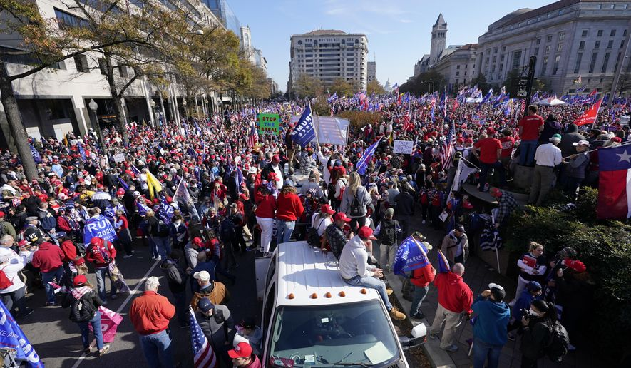 Supporters of President Donald Trump rally at Freedom Plaza on Saturday, Nov. 14, 2020, in Washington. (AP Photo/Julio Cortez)
