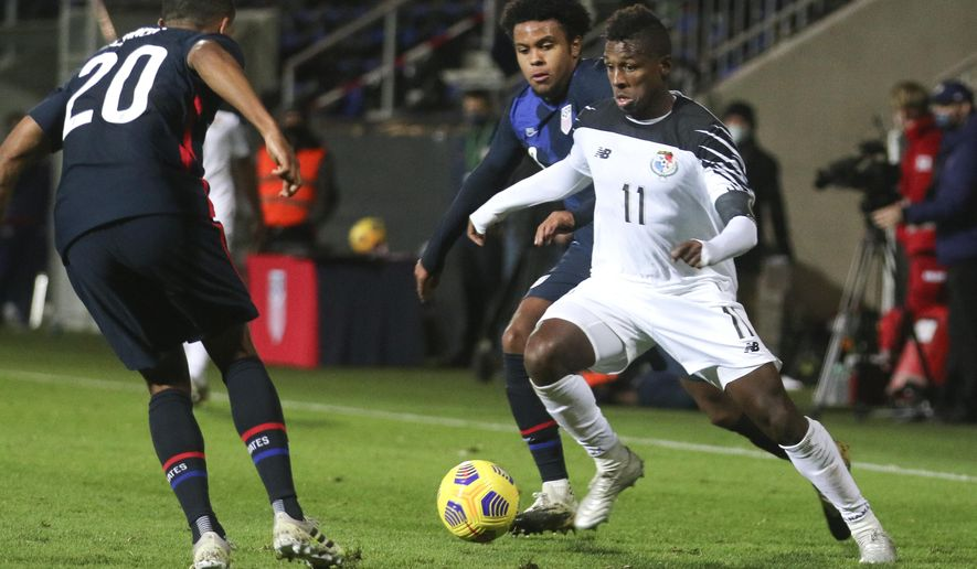 Panama's Armando Cooper, right, looks to take the ball past United States' Reggie Cannon, left, during the international friendly soccer match between the USA and Panama at the SC Wiener Neustadt stadium in Wiener Neustadt, Austria, Monday, Nov. 16, 2020. (AP Photo/Ronald Zak)