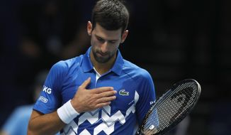 Novak Djokovic of Serbia celebrates winning match point against Diego Schwartzman of Argentina during their singles tennis match at the ATP World Finals tennis tournament at the O2 arena in London, Monday, Nov. 16, 2020. (AP Photo/Frank Augstein)